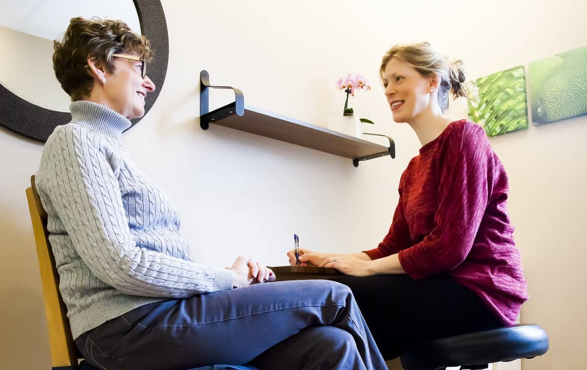 Cancer rehabilitation consultation between physiotherapist and patient