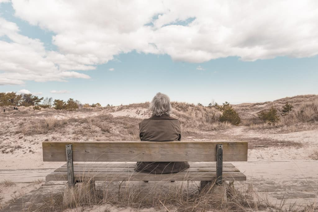 Woman on a bench as a metaphor for lymphedema risk